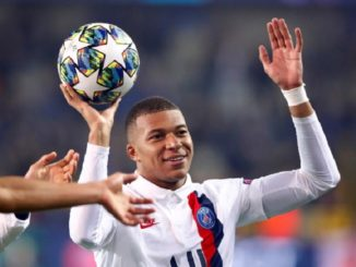 Soccer Football - Champions League - Group A - Club Brugge v Paris St Germain - Jan Breydel Stadium, Bruges, Belgium - October 22, 2019 Paris St Germain's Kylian Mbappe celebrates after the match with the match ball REUTERS/Francois Lenoir