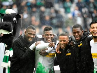 Gladbach players celebrate win over Augsburg