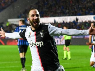 Juventus Gonzalo Higuain scores his second goal and celebrates