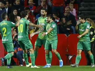 Portu celebrates his second goal with Real Sociedad players.