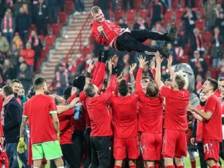 Union Berlin players celebrate after their win over leaders Monchengladbach