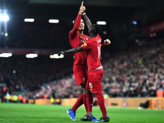 Sadio Mane and Virgil Van Dijk celebrate Liverpool's 3rd goal.